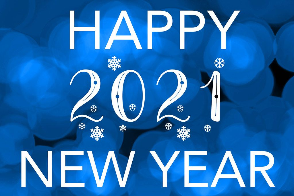 Happy 2021 new year on blurred blue bokeh background