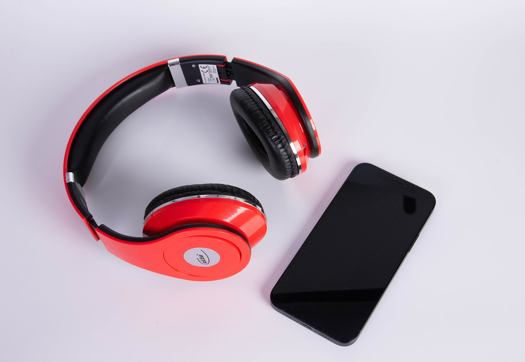 Headphones and smartphone on a white background