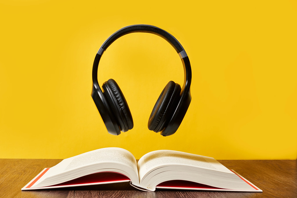 Headphones over open pages of a book