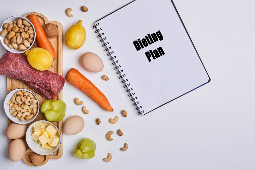 Healthy food background with dieting plan on the notepad