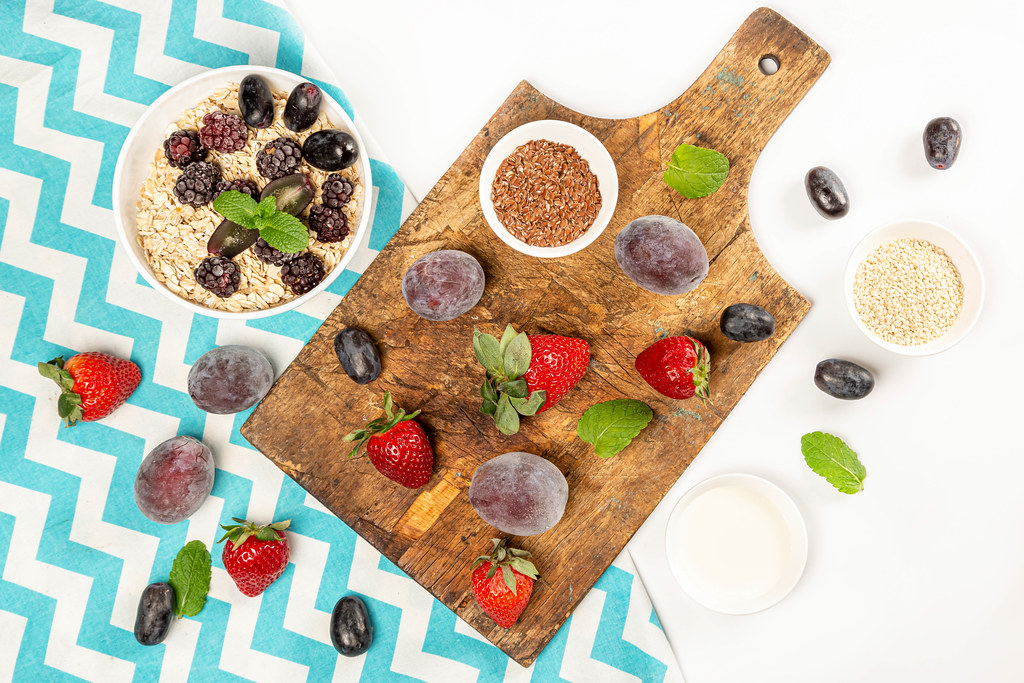 Healthy food background with oatmeal, berries and seeds