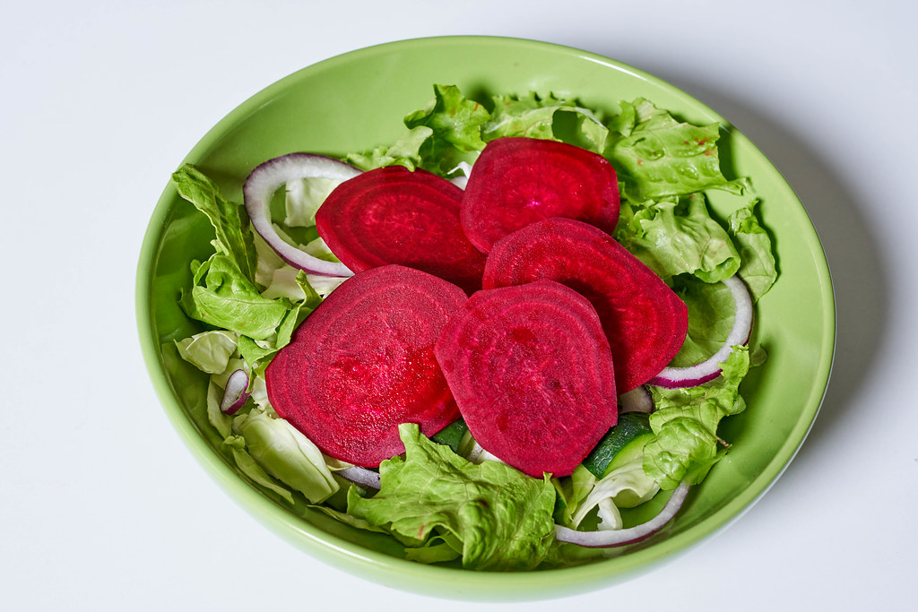 Healthy salad with beets and mixed greens