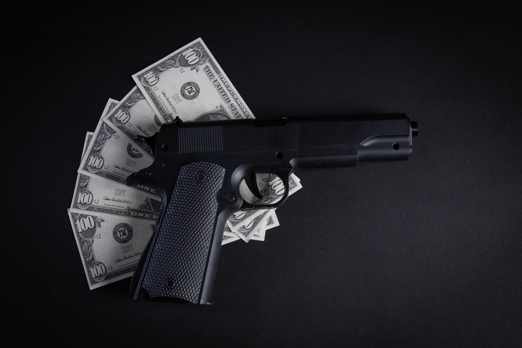 Heap of money and handgun