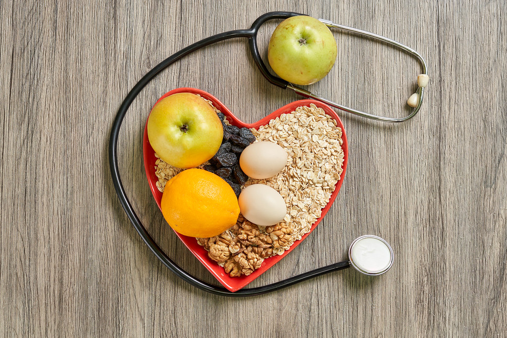 Heart-healthy foods with stethoscope on wood