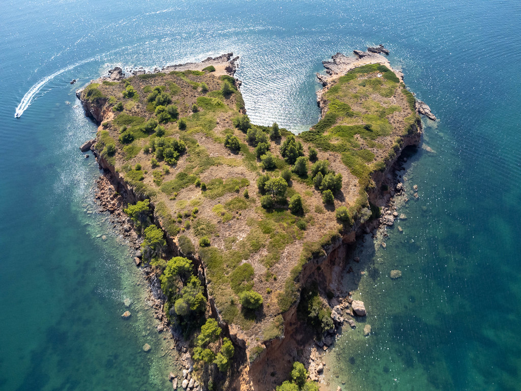 Heart-shaped headland formed by the reddish cliffs at Kokkinokastro beach, Alonnisos. Drone photography