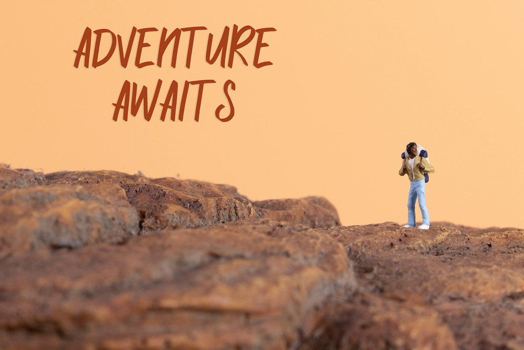 Hiker and Adventure awaits text