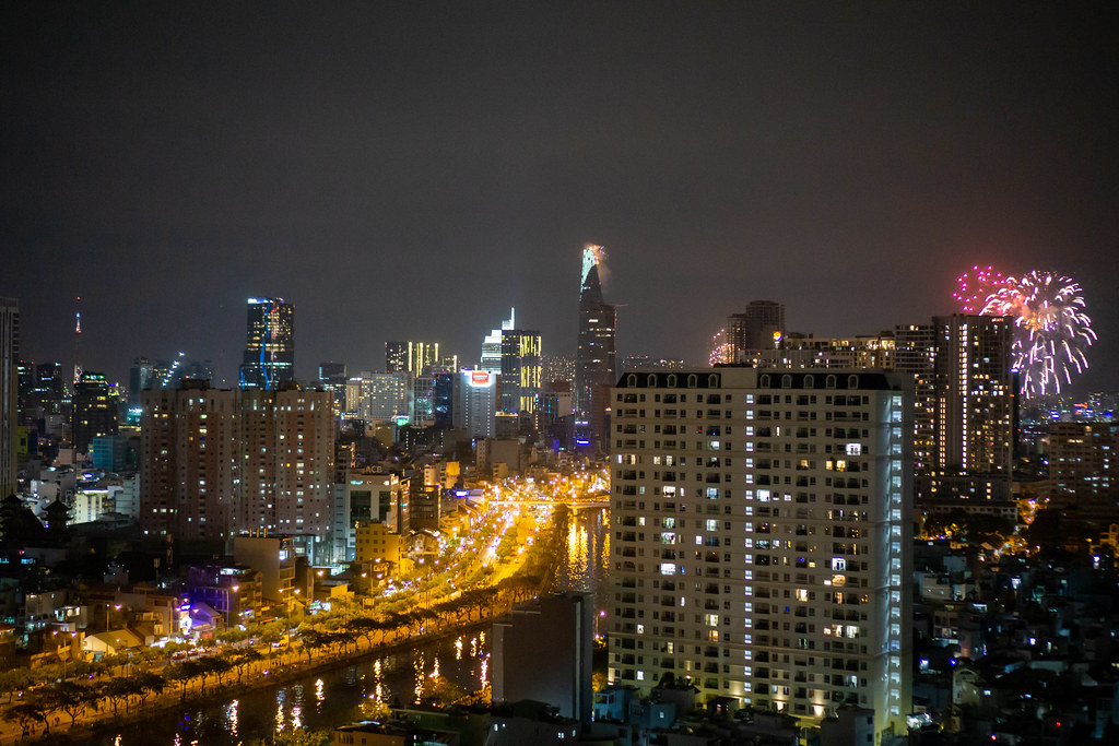 Ho Chi Minh City Night Photo with Bitexco Financial Tower and 2021 New Year Fireworks at Landmark 81 and Saigon River
