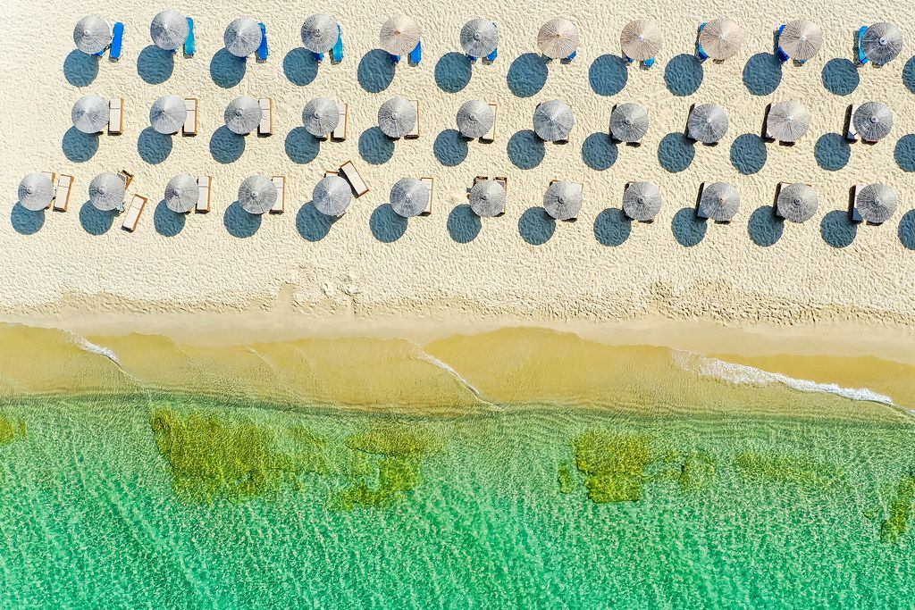 Holiday in summer 2020 on an empty beach in Greece. Drone shot of Plaka, Naxos, south Aegean