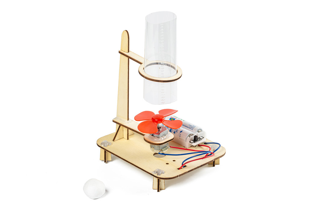 Homemade children's toy - model of a wind tunnel on a white background