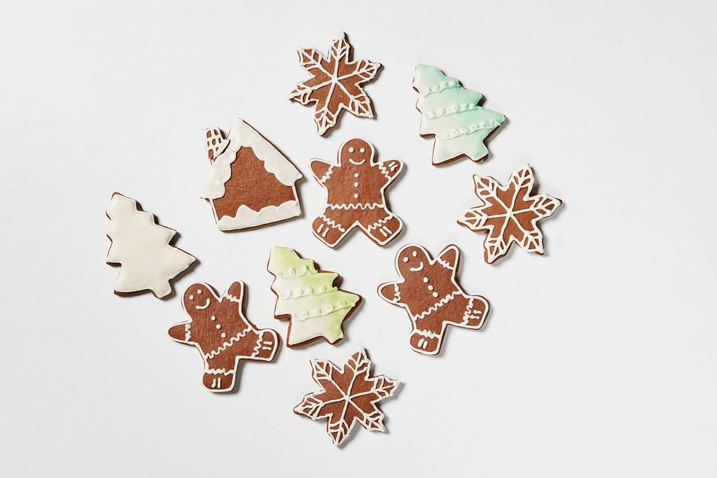 Homemade funny X-mas cookies on white