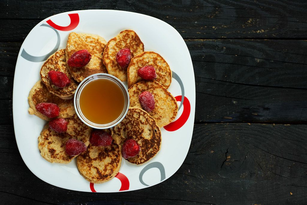 Honey-Oat Pancakes with frozen strawberry fruits