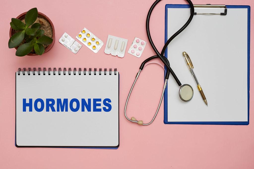 Hormonal pills on doctors workspace