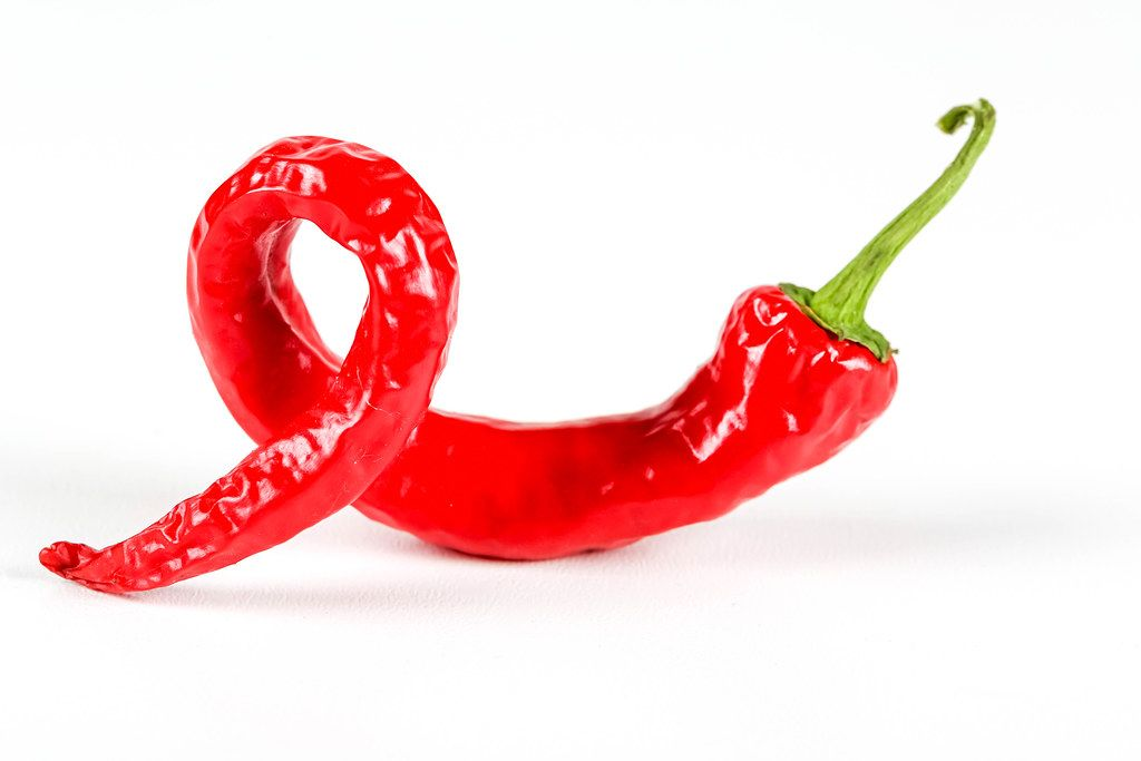Hot red chili pepper on white background
