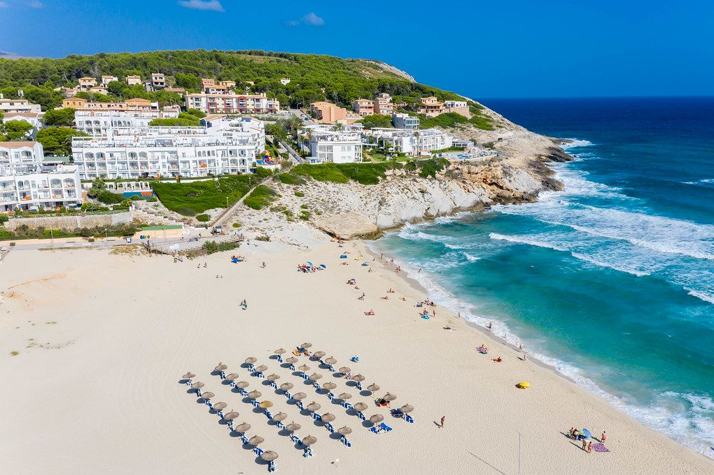 Hotels and tourist apartments directly at the beach of Cala Mesquida, Mallorca. Aerial view