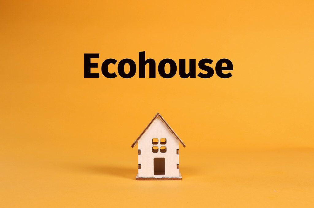 House with Ecohouse text on orange background