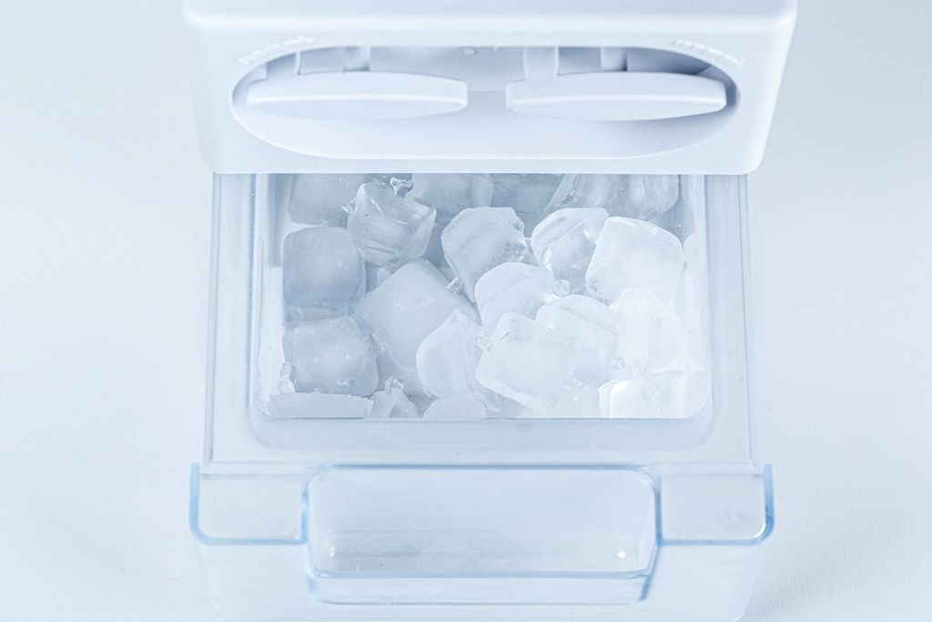 Ice from the fridge. Containers for ice in the refrigerator