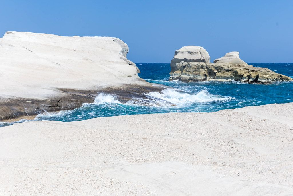 Interesting rock formations meet the waves of the Aegean sea on the deserted coast of Milos, Greece