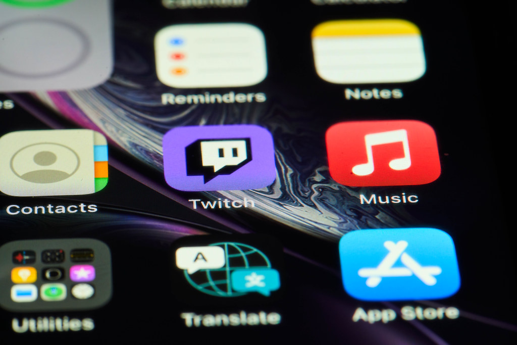 iPhone home screen with Twitch and other application icons