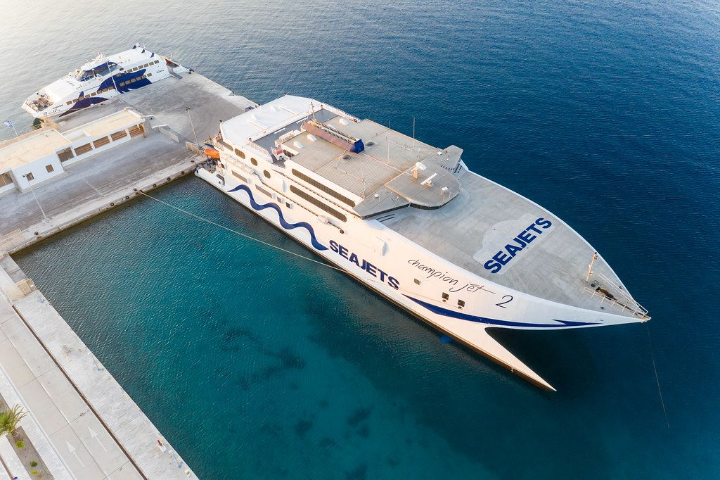 Island hopping by ferry and catamaran in the South Aegean. Seajets passenger boats in the port of Milos