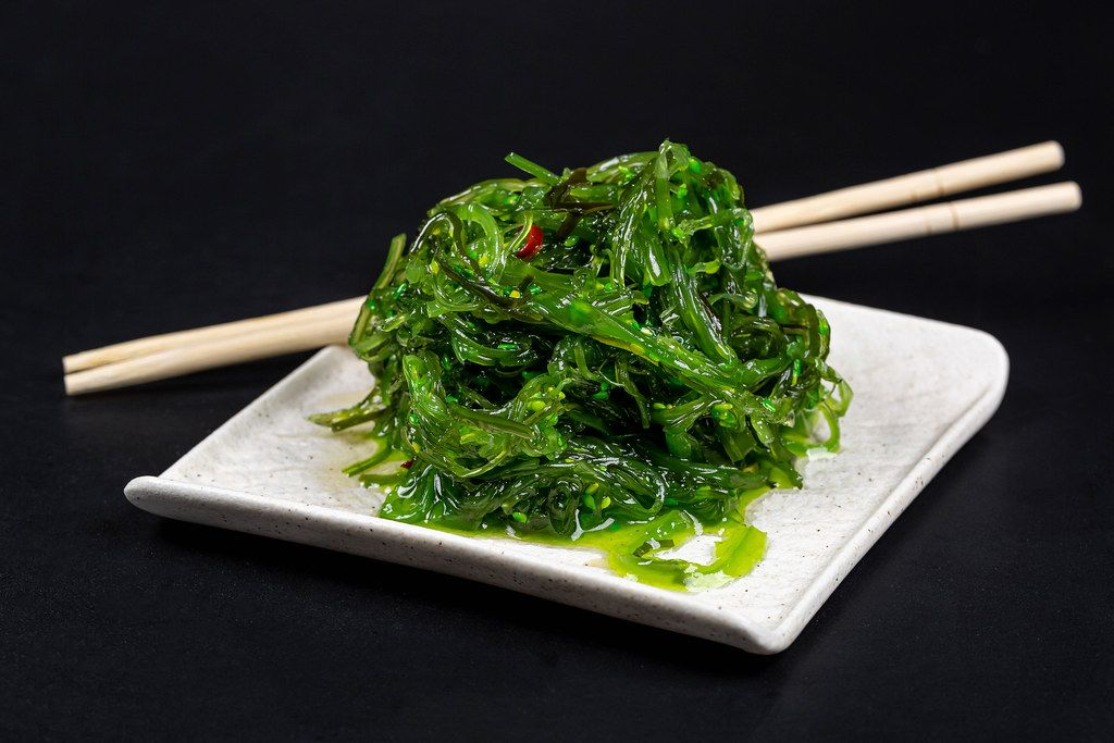 Japanese cuisine - chuka seaweed salad, served with nuts sauce and sesame