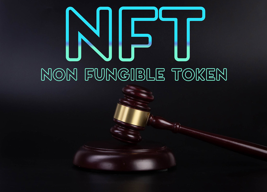 Judge gavel with NFT Non Fungible Token text on black background
