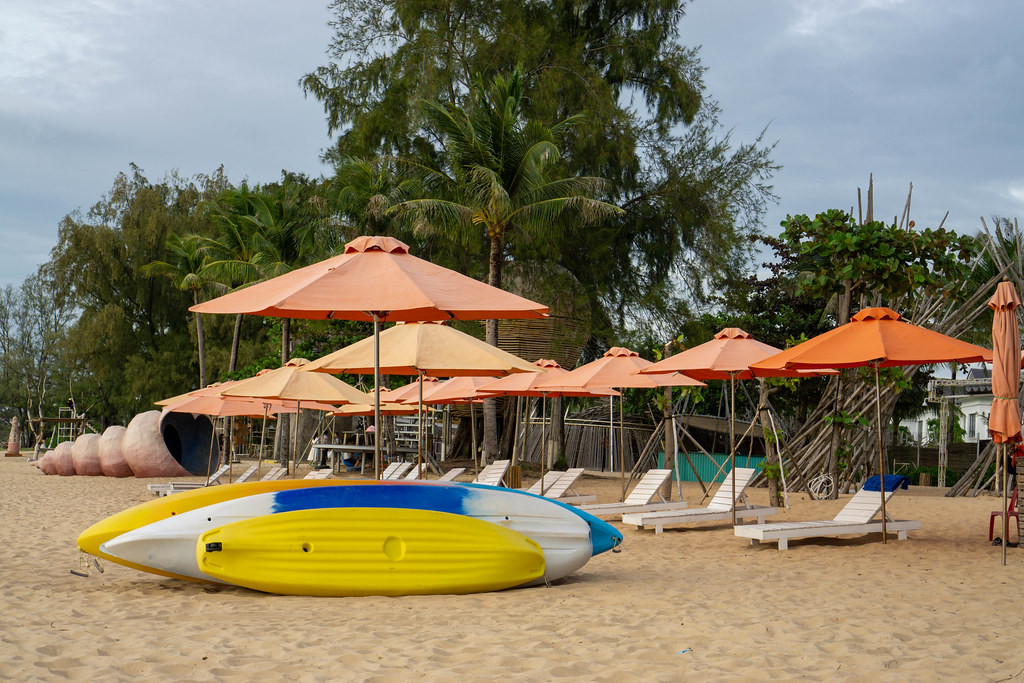 Kayak, Sunbeds and Sun Umbrellas on the Sand Beach at Sunset Sanato Beach Club in Phu Quoc, Vietnam