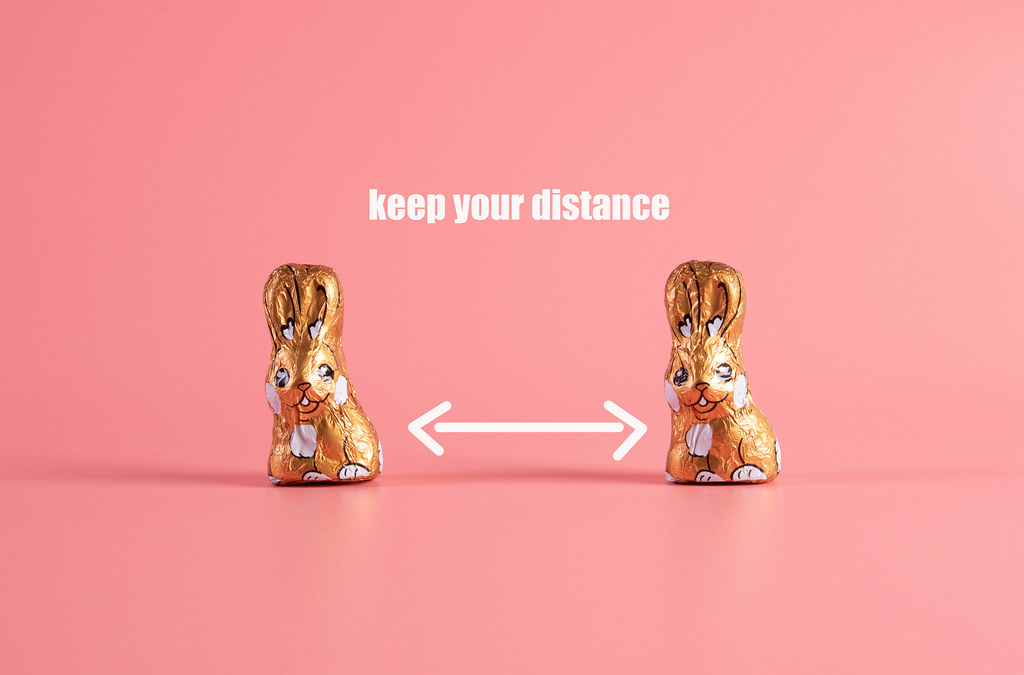 Keep your distance concept with two chocolate easter bunnies