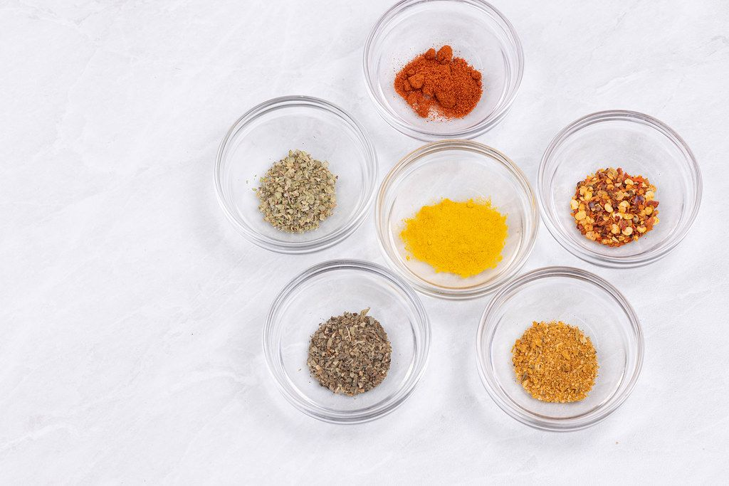 Kitchen Spices in the glass bowls on the table