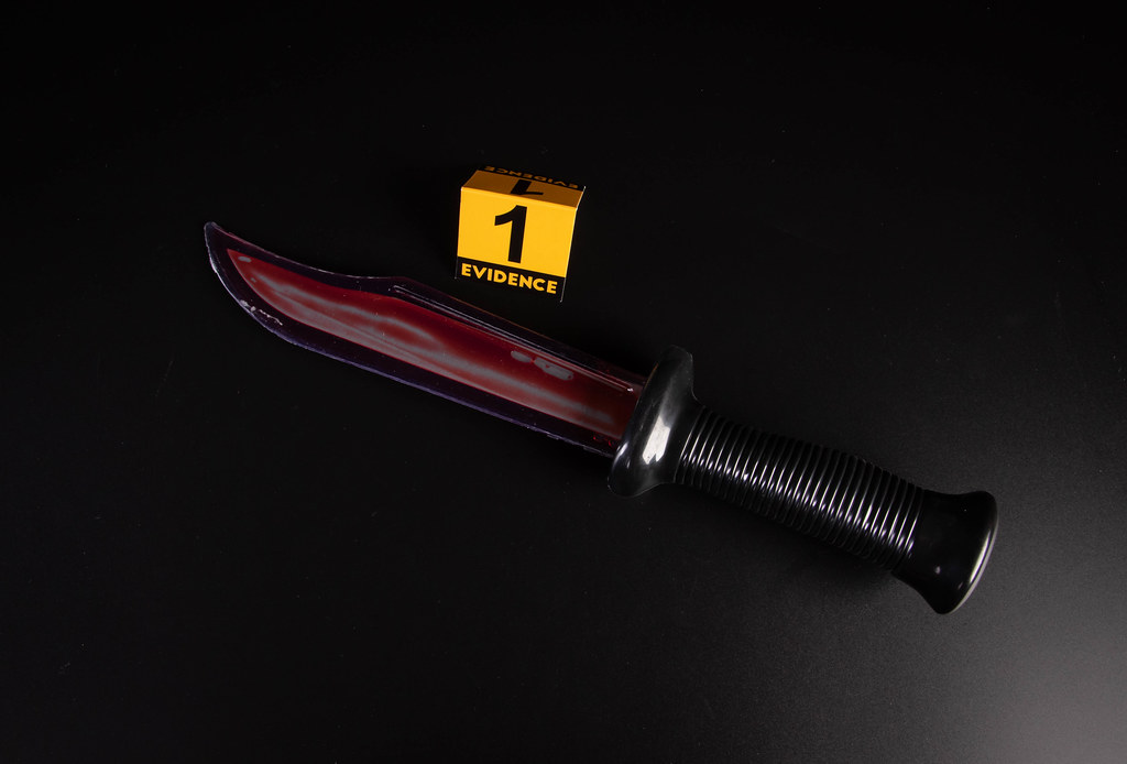 Knife with grungy blood mark, crime murder and violation concept
