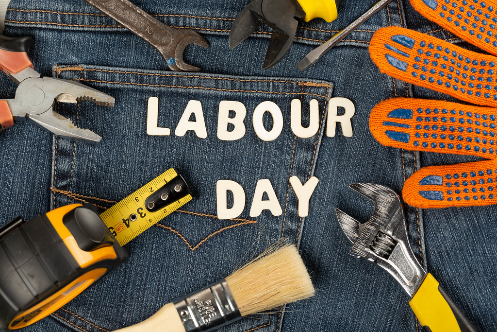 Labor day background with tools on jeans backdrop