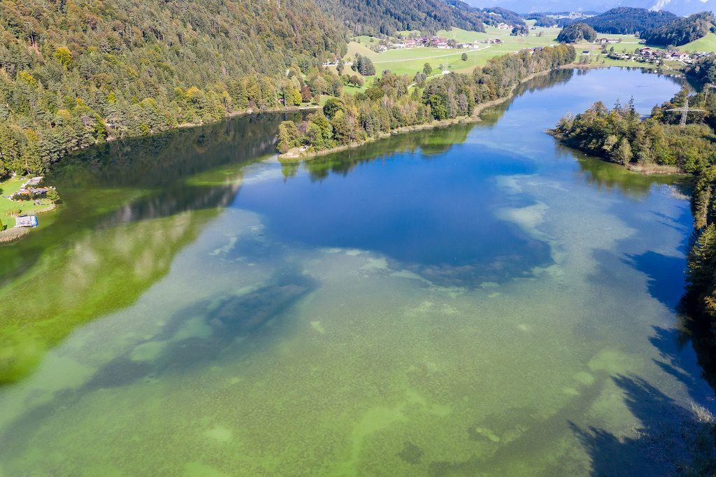 Lake Reintal: the largest of the Kramsach Lakes in the Alpbach Valley. Aerial view in autumn