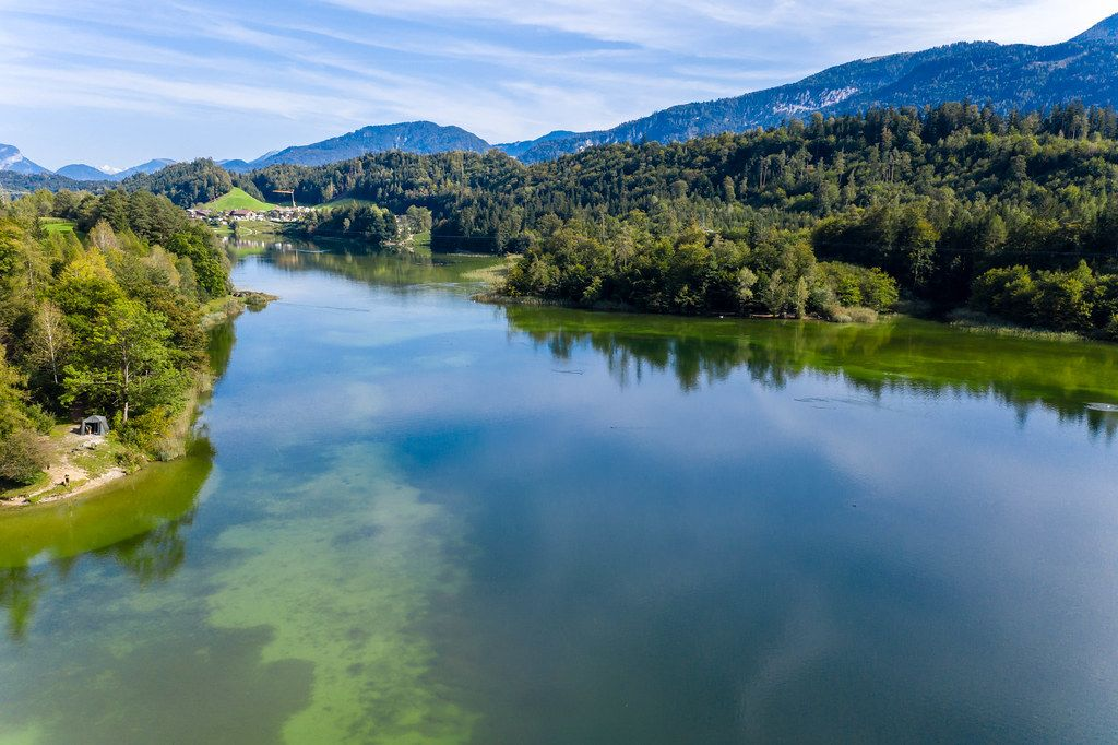 Landscape in the Austrian Alps in autumn: lake Reintal near Kramsach - village of lakes. Drone shot
