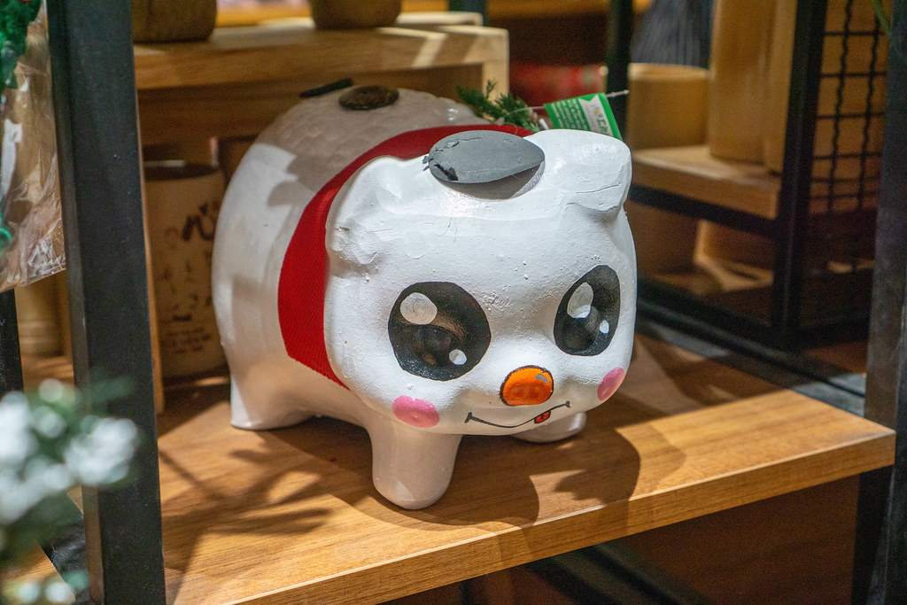Large Decorative Piggy Bank for the Year of the Pig in Lunar Calendar for Sale in a Wooden Shelf