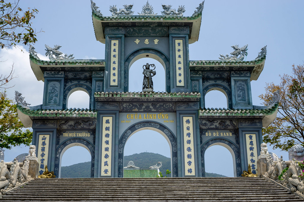 Large Stone Gate in the End of a Stairway with Chinese Letters, Statues and Ornaments at the Linh Ung Pagoda on Son Tra Peninsula in Da Nang, Vietnam