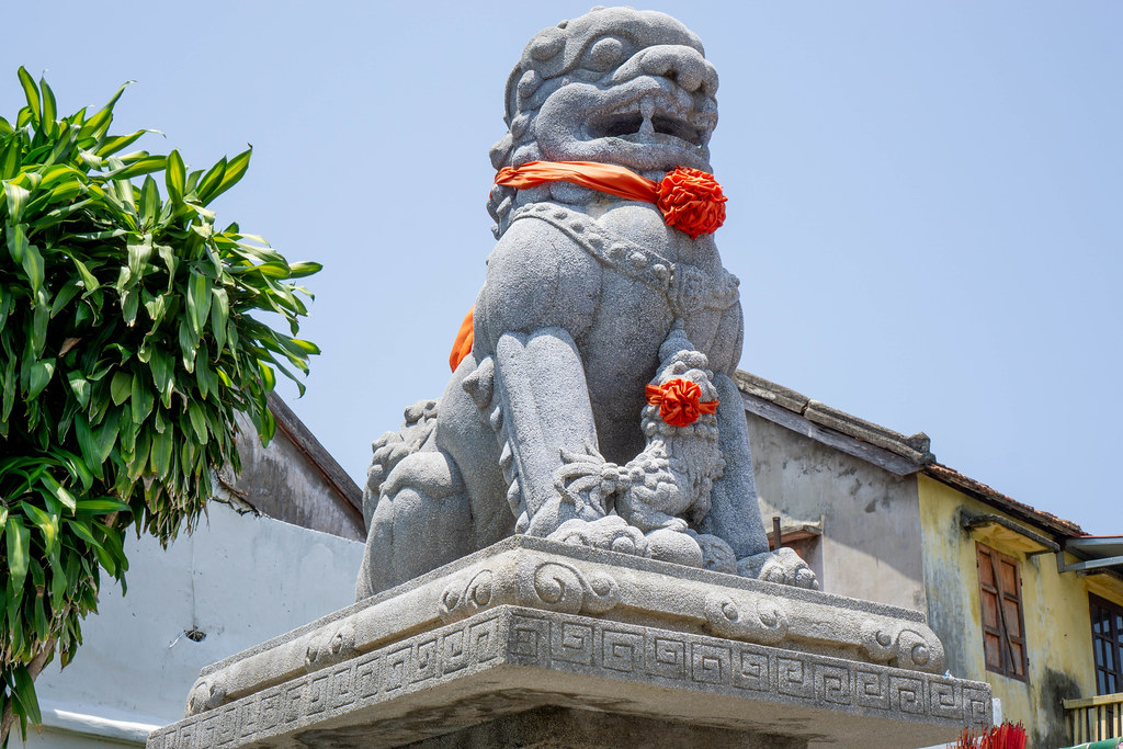 Large Stone Statue of a Chinese Guardian Lion at the Assembly Hall of Fujian Chinese and Phuc Kien Pagoda in Hoi An, Vietnam