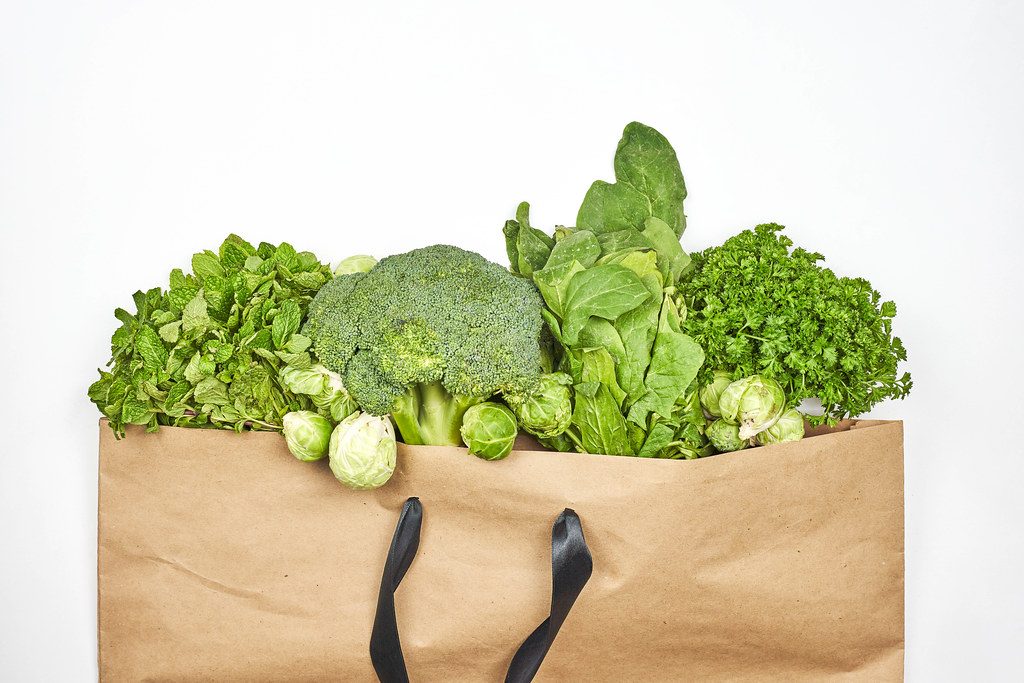 Leafy greens in the paper shopping bag