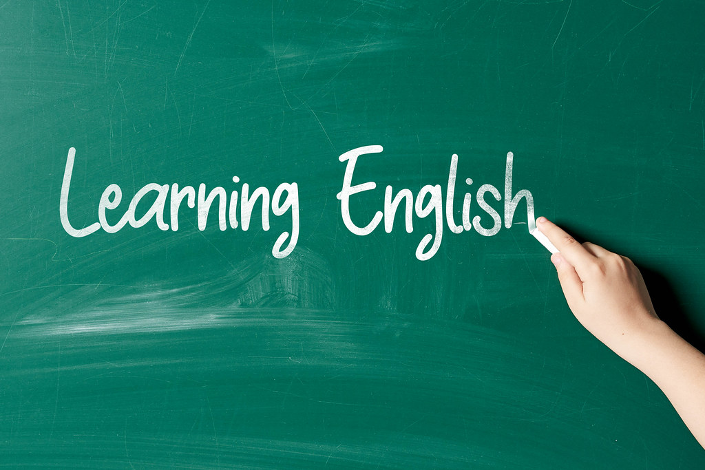Learning English phrase written on the chalkboard