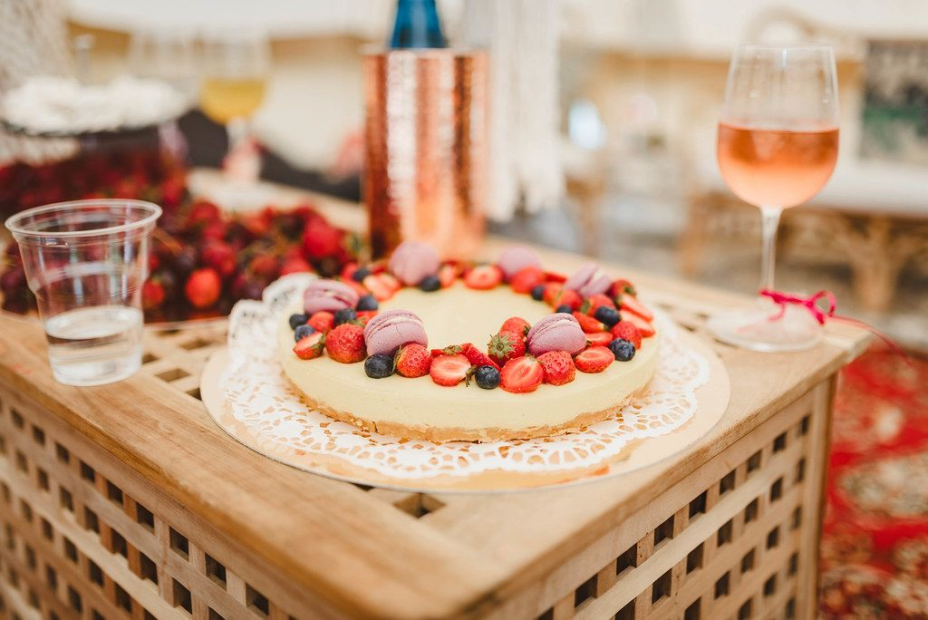 Lemon Cake With Berries And Wine On The Wooden Table