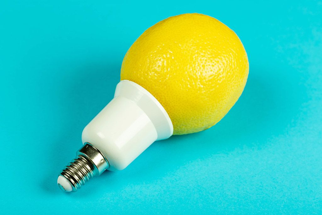 Lemon light bulb on blue background