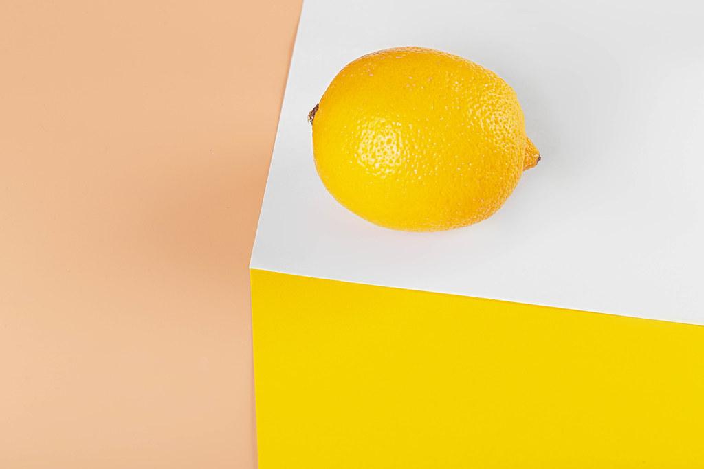 Lemon on white yellow and orange background
