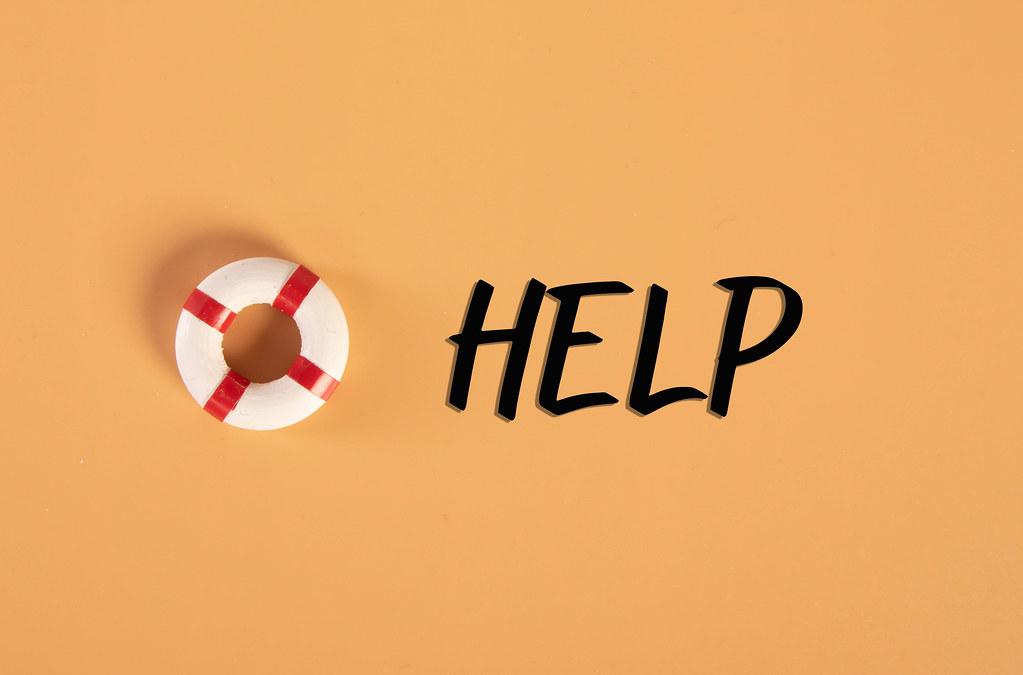 Lifebuoy with Help text on orange background