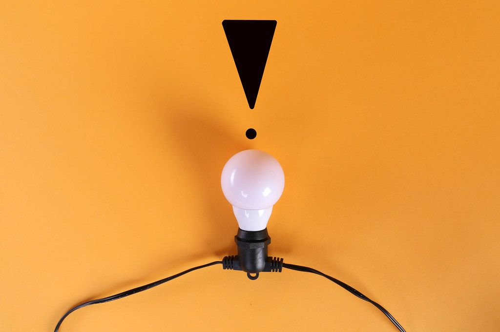 Light bulb with exclamation mark