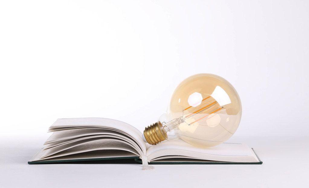 Lightbulb on the open book