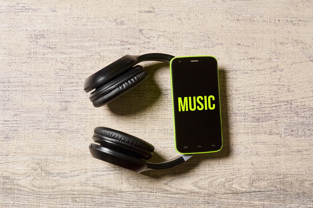 Listening to music - Wireless headset and mobile phone with text music