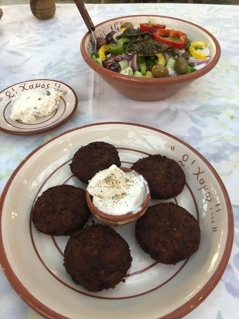 Local Greek food: Aubergine meatballs with dip, colorful salad and pistachio ice cream from O Hamos Tavern in Milos