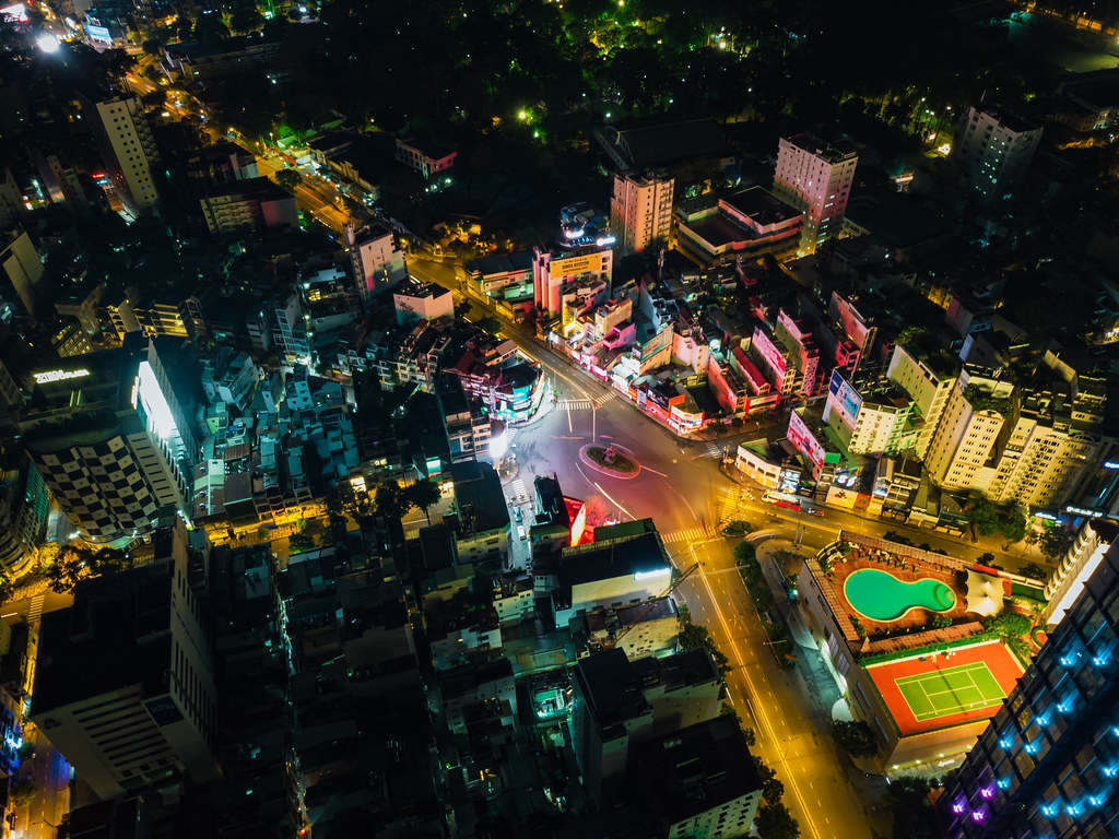 Long Exposure Drone Photo of Swimming Pool and Tennis Court next to Phu Dong Roundabout with Thanh Giong Monument in Ho Chi Minh City, Vietnam