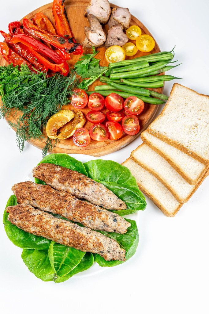 Lulia Kebab with fresh vegetables, grilled vegetables and slices of bread