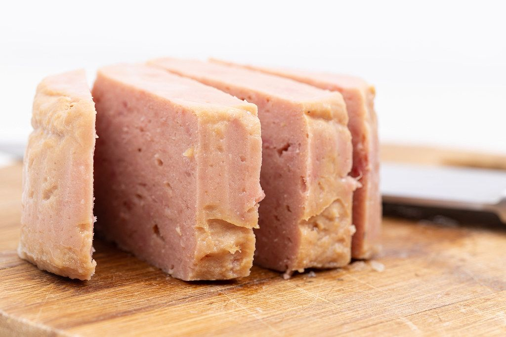 Luncheon Meat served on the wooden board