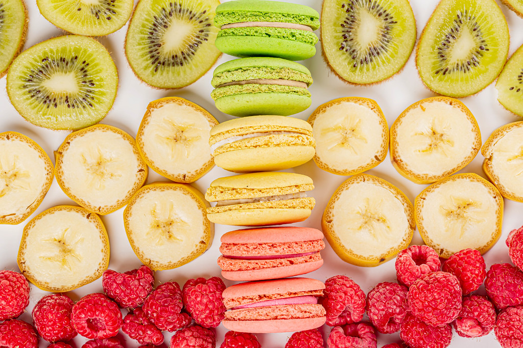 Macaroons dessert with fresh fruits and berries