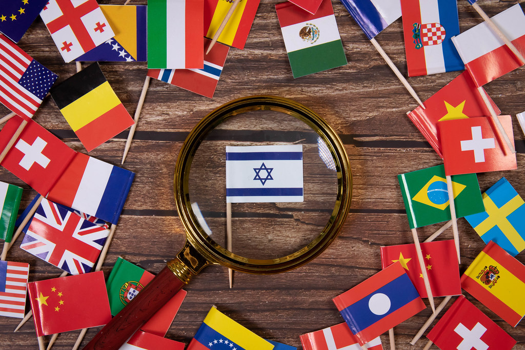 Magnifying glass on the flag of Israel